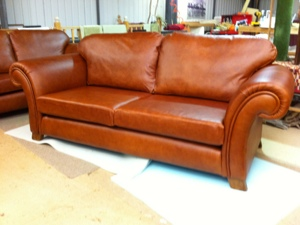 Fabric to leather reupholstery