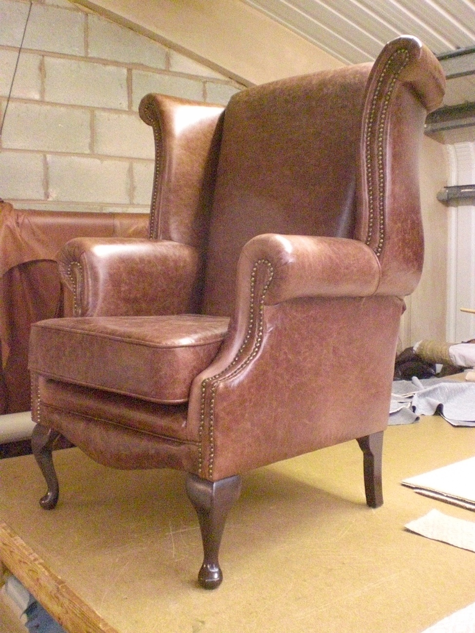Distressed Manor Wing Chair in Leather